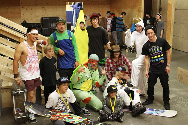 This photo from the 2010 Tricks for Treats event in the Woodward Copper barn features a young Red Gerard (second from left), members of Woodward Copper's staff and pro snowboarder Josh Sherman on the far right.