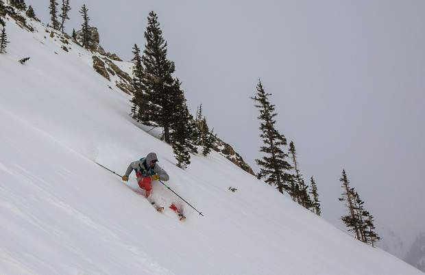 Taking advantage of being first on fresh snow, skier Doug Stenclik descends in the Silver Couloir on April 13, on Buffalo Mountain near Silverthorne.