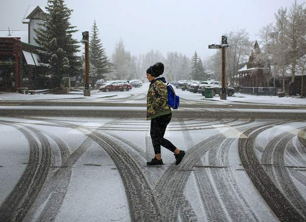 Breckenridge resident Elisa Gomez waits for the bus along French Street Thursday, May 23, in Breckenridge.