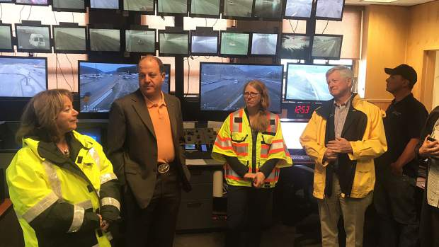 Gov. Polis signs new traction, snowplow laws outside Eisenhower Tunnel
