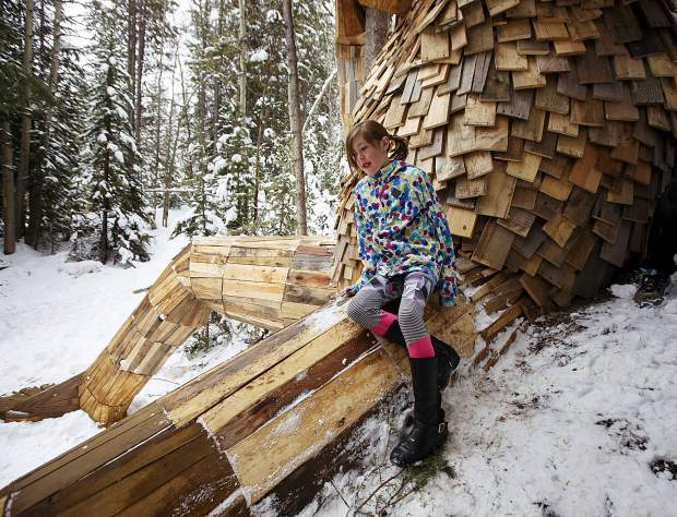 Paige Batdorff sits on the leg of Isak Heartstone Friday, May 10, at the new location in Breckenridge.