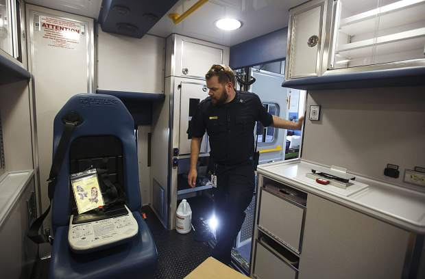 Summit Fire and EMS Paramedic Supervisor Austin Wingate takes a look inside the new ambulance at the fire station Wednesday, June 12, at Station 10 in Silverthorne.