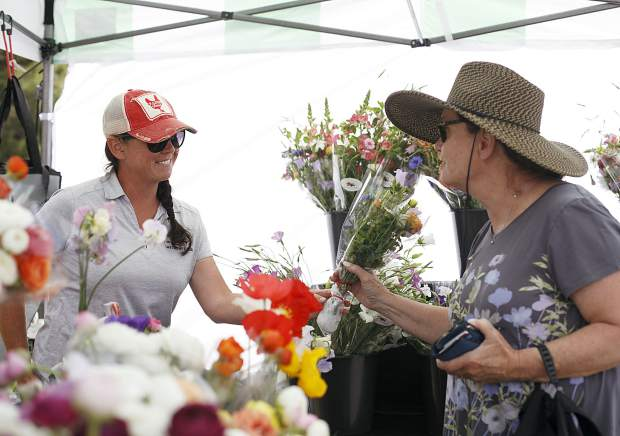 People shop for plants and fresh produce during the Dillon Farmers Market Friday, June 7, in Dillon.