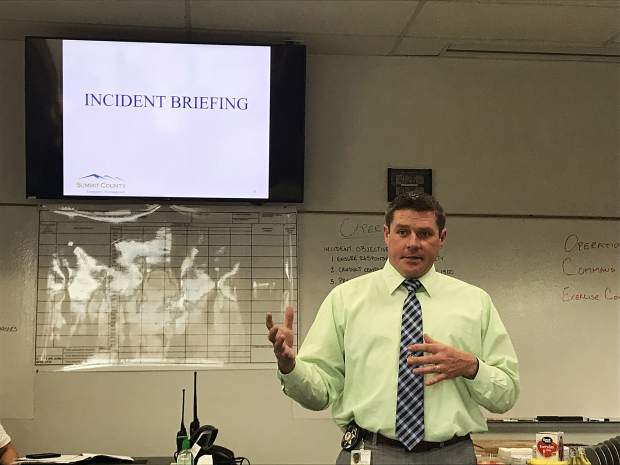 Summit County Emergency Management director Brian Bovaird addresses officials at the emergency operations center in Frisco on Friday, May 31, 2019.