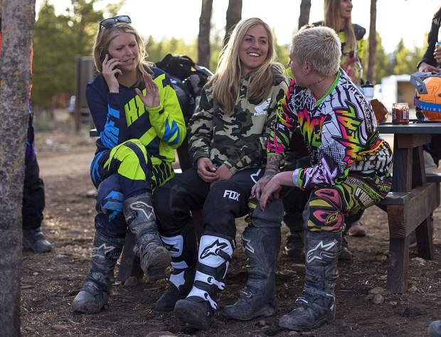 Girls-night riders (from left to right) Kristen Kohl, Ali Leonard and Ali Gee hang out while taking a shaded break between runs during the weekly