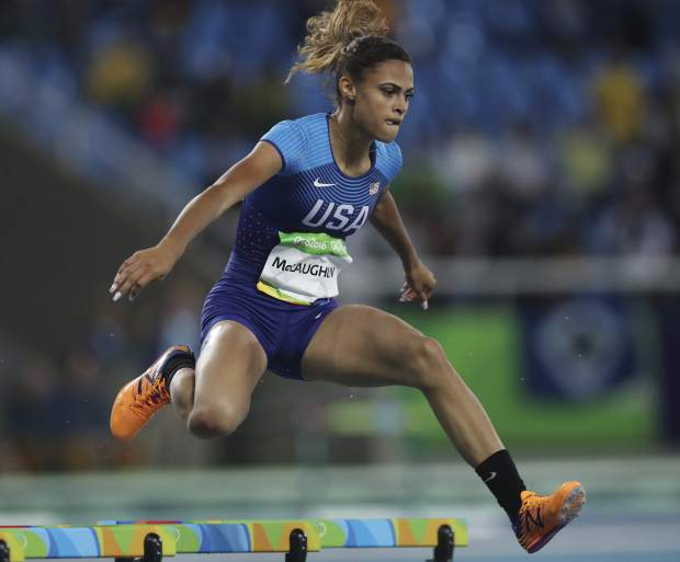 FILE - In this Aug. 15, 2016, file photo, United States' Sydney McLaughlin competes in a women's 400-meter hurdles heat during the athletics competitions of the 2016 Summer Olympics in Rio de Janeiro, Brazil. McLaughlin's name constantly surfaces among the ones to watch heading into the Tokyo Games next summer. (AP Photo/Lee Jin-man, File)