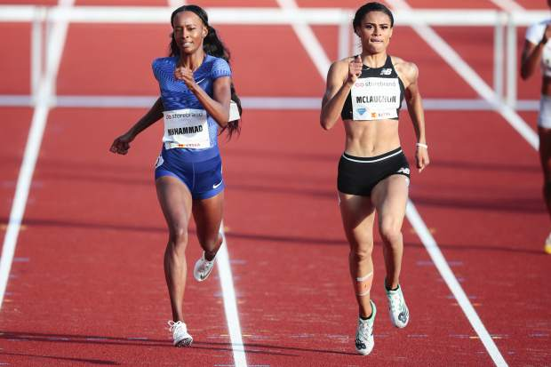 FILE - In this June 13, 2019, file photo, Dalilah Muhammad, left, and Sydney McLaughlin, both from the United States, compete in the women's 400m hurdles event at the IAAF Diamond League athletics competition in Oslo, Norway. McLaughlin took first place. McLaughlin's name constantly surfaces among the ones to watch heading into the Tokyo Games next summer.