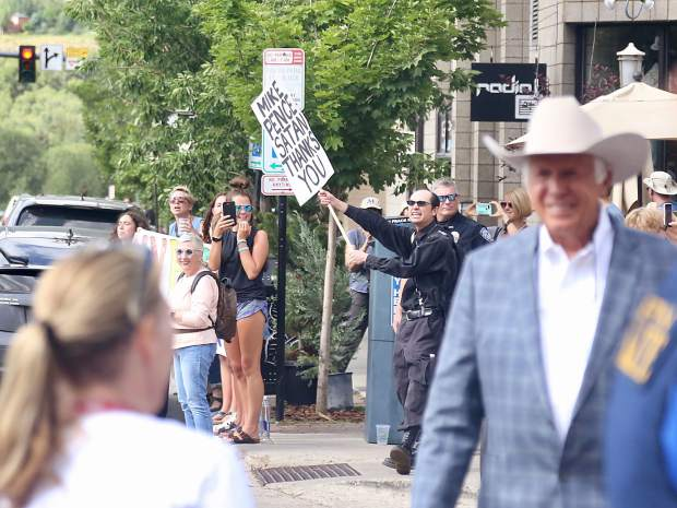 Protesters stand on the street corner as Vice President Mike Pence leaves the Caribou Club in downtown Aspen on Monday, July 22, 2019. (Photo by Austin Colbert/The Aspen Times)